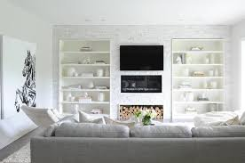 living room with built in bookcases flanking fireplace
