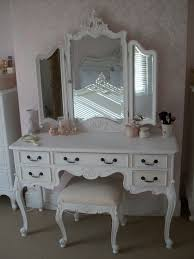 white wooden carving makeup vanity with three mirror panels and drawers also claw legs