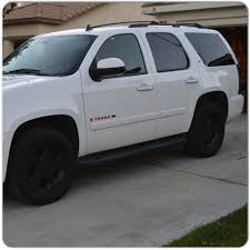 White Tahoe with pink emblems, black rims, and taillights ...