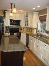 White Kitchen Cabinets With Dark Brown Island