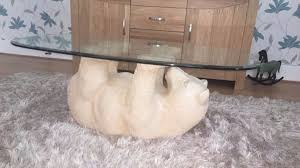 polar bear coffee table good condition cream base with heavy glass top southampton