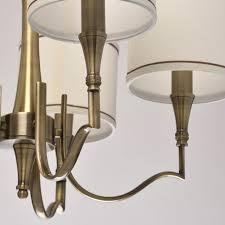 elegant 5 arm pendant chandelier in antique brass with cream fabric shades