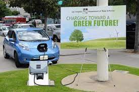 Photo Caption Nissan Leaf Used To Promote 39 Charge Up La 39 Electric Car Charge Stat Electric Vehicle Charging Station Electric Car Charging Nissan Leaf