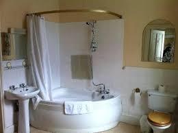 corner shower tub small bathroom corner tub shower like the idea of new shower head no