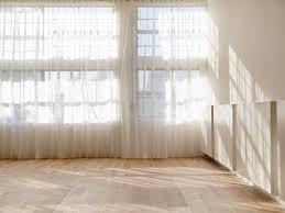 oak planks line a yoga studio s floor at one hot yoga pilates in sydney australia by rob mills architects interior designers
