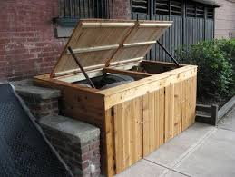 Image Fence Squirrels And Other Critters Arent Cute Anymore When Theyre In Your Garbage Cans Check Out These Outdoor Trash Can Storage Ideas To Keep Them At Bay Pinterest Attractive Outdoor Trash Can Storage Beach Garbage Can Storage