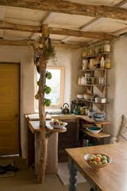 Rustic Small Kitchen With Wooden Dining Table Wooden Countertop And Oak Wood  Pillar Image