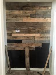 i worked my way down the wall trying to make sure that i changed things up with the pattern to make it as random as i could the pallet boards aren t all