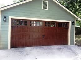 Clopay Gallery Collection grooved panel steel garage door with Ultra-Grain  finish. Long panel