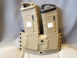 Kydex Magazine Holder I would like a source for a double mag pouch PMag to be worn on 48
