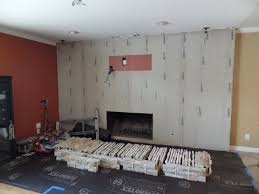 installing stone veneer panels on wall with t v