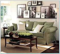 how to decorate a large wall wll imges above tv behind couch empty space