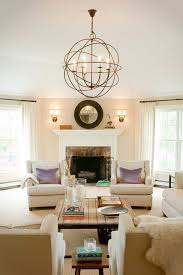 family room lighting. Family Room Lighting Design Living Transitional With Off-white Armchairs Stacked Books Square Coffee T