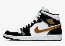 the air jordan 1 mid returns to black and gold patent leather