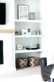 built in shelves around wondrous fireplace surround styling our new floating tv room