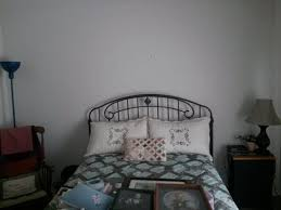 i need help with this bare wall especially what to put above the curved headboard this is a small guest room if you have any suggestions or links to pics