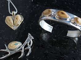 elk ivory tooth jewelry for the hunter in your life custom gold and silver jewelry elk tooth jewelry