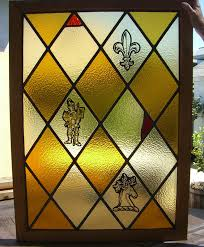 fleur de lis stag diamond pattern stained glass window