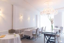 a venetian chandelier upholstered louis xv chairs velvets and white cotton tablecloths simple clean table settings that are both contemporary and