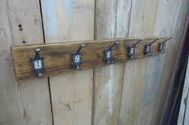 vintage design numbered coat rack cast iron numbered hooks 1 6 on bespoke recycled waxed pine backboard