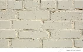 Texture: Brick wall painted in light yellow color.