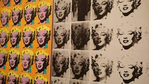 it is also said that through this style of work warhol refers to a society in which people can be seen as a rather than a person