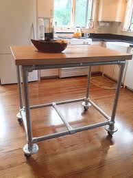 small kitchen island with a wood top