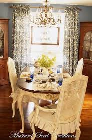 love the warm toned wood off white chairs this is almost my exact dining room set up down to the two corner hutches
