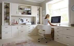 Image modern home office desks Minimalist Clean Look For Modern Home Office Desks With Large Window And Cabinets Kyeanorg Furniture Clean Look For Modern Home Office Desks With Large Window