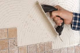 installing tile over concrete walls is possible but presents some unique challenges