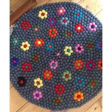 100cm felt ball rug in black with flower