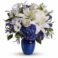 blue and white flowers designed in a classic blue vase beautiful in blue bouquet