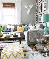 interior with a vintage scandinavian rug and a grey couch