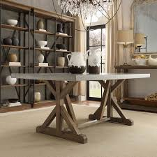 ellary rustic pine concrete topped trestle base dining table