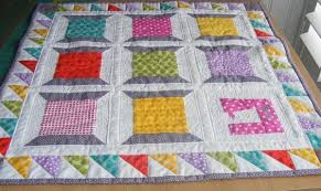 9 Exciting Border Ideas for Quilt Patterns & Colorful Spool Quilt - Craftsy Adamdwight.com