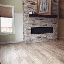 a new fireplace new flooring new baseboard yet to be installed helped transform this sw rochester home this is urban surfaces sound tec in the color