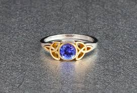 the yellow gold setting complements the purple blue tanzanite perfectly a low profile bezel setting ensures the tanzanite is well protected