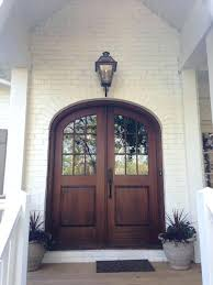 brown arched glass front door on white brick home front door with glass side panels front door with glass storm door front door with glass and wrought iron