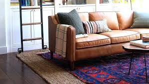 diy area rug from carpet designer jenny living room where a red and blue statement rug