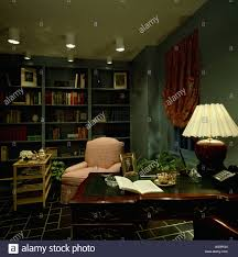 Lighted Desk Lighted Lamp On Desk In Eighties Study With Spotlights And