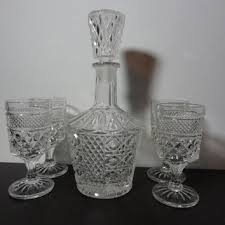 vintage clear glass liquor or wine decanter with set of 4 wine o