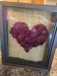Rose petals from funeral flowers in shadow box.
