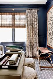splashy navy blue curtains in an eclectic living room