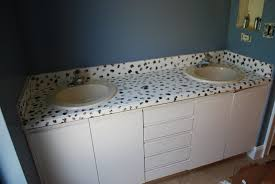 painting bathroom countertops. base in a random pattern, making sure to not overlap the two colors too much, just occasionally. try convince yourself that countertop really is painting bathroom countertops p