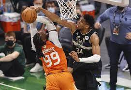 Giannis scores 50, Bucks close out Suns ...