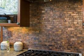 copper tiles create a cool backsplash in the traditional kitchen design welsh construction
