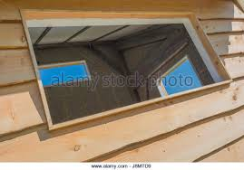 outside office shed. three empty windows spaces in an outside office shed building stock image