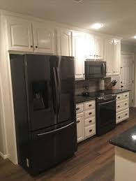 kitchen design white cabinets stainless appliances. Delighful Cabinets Black Stainless Steel Appliances Steel Gray Counter Tops Benjamin Moore  Simply White Cabinets Silver Travertine Backsplash With Delorean Gray Grout Inside Kitchen Design Cabinets Stainless Appliances I
