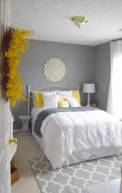bursts of yellow provide warm energy in these soft grey bedroom