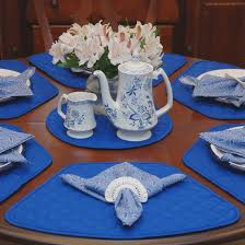 enticing dining room decoration ideas with ocean blue placemat and round wooden folding table decorations